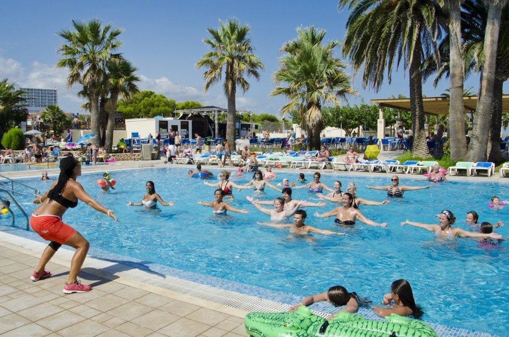 Rozcvička v bazénu s animátorem, CLUB HOTEL AQUAMARINA 3*, Menocra, Španělsko.
